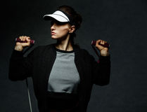 Fit woman workout with resistance band against dark background Royalty Free Stock Photos