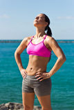 Fit woman worshiping the sun Royalty Free Stock Photography