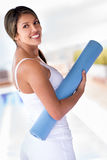 Fit woman with a yoga mat Stock Photo