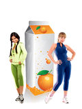 Fit women with a carton of orange juice Royalty Free Stock Photos