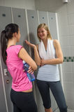Fit women chatting in locker room Royalty Free Stock Photo