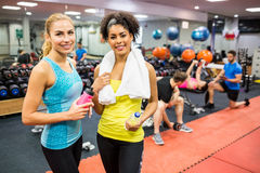 Fit women chatting in weights room Stock Images