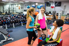 Fit women chatting in weights room Royalty Free Stock Photos