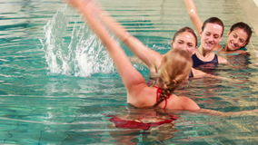 Fit women doing aqua aerobics in the pool stock video