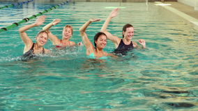 Fit women doing aqua aerobics in the pool Royalty Free Stock Photography