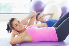 Fit women doing pilate exercises in fitness studio Royalty Free Stock Photos