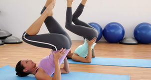 Fit women doing pilates together in studio stock footage