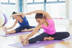 Fit women doing stretching pilate exercises Royalty Free Stock Photography