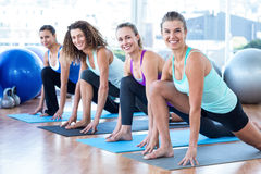 Fit women in fitness studio doing high lunge pose Royalty Free Stock Photo