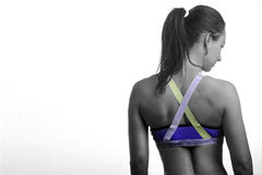 Fit women with her back to the camera. Image of a fitness model after a workout at the gym Stock Photography