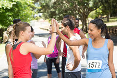 Fit women high fiving before race Royalty Free Stock Photo