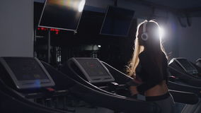 Fit women running on treadmills in the gym stock video
