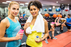 Fit women smiling at camera in weights room Royalty Free Stock Photo