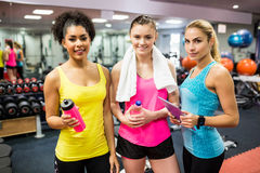 Fit women smiling at camera in weights room Royalty Free Stock Image