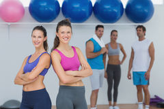Fit women in sports bra with friends in background Royalty Free Stock Photo