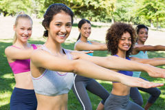 Fit women stretching in park Stock Photos