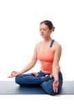 Fit yogini woman meditating in yoga asana Stock Photography