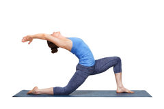 Fit yogini woman practices yoga asana Anjaneyasana stock photo
