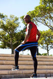 Fit young african man standing on steps at the park. Full length portrait of fit young african man standing on steps at the park Royalty Free Stock Photography