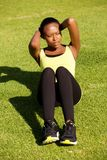 Fit young african woman doing stomach crunch Royalty Free Stock Photo