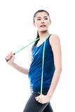 Fit young Asian woman with a skipping rope Royalty Free Stock Images