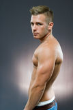 Fit young athlete. Half lenth portrait of fit young handsome man Royalty Free Stock Images
