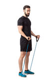 Fit young bearded athlete preparing for bicep muscle arms exercise Royalty Free Stock Photos