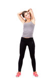 Fit young beauty stretching arm triceps over her head Stock Photography