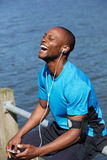 Fit young black guy laughing Stock Photo