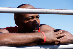 close up of a african sportsman leaning on the railing stock image