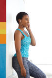 Fit young black woman listening to music with earphones Stock Photos