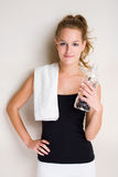 Fit young blond. Portrait od a fit young blond with water bottle Royalty Free Stock Images