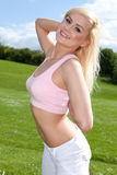 Fit young blonde woman in a pink top Stock Photo