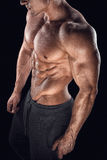 Fit young bodybuilder fitness male model posing Stock Images