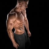 Fit young bodybuilder fitness male model posing Royalty Free Stock Photo
