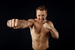 Fit young boxer is exercising with consecration Royalty Free Stock Images