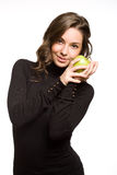 Fit young brunett with apple. Royalty Free Stock Photos