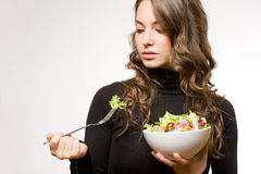 Fit young brunette with salad. Royalty Free Stock Photos