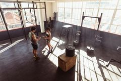 Fit young couple at cross training gym Stock Photo