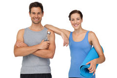 Fit young couple with exercise mat and water bottle Royalty Free Stock Photos