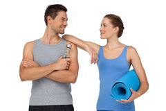 Fit young couple with exercise mat and water bottle Stock Images