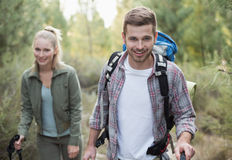 Fit young couple exploring the woods Stock Images