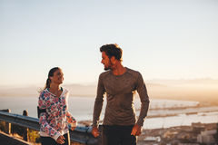 Fit young couple jogging outdoors Royalty Free Stock Images