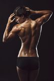 Fit young female bodybuilder posing Stock Photo