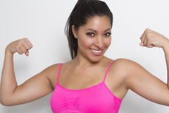 Fit young female flexing Royalty Free Stock Photos