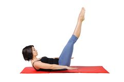 Fit young female pilates instructor Royalty Free Stock Photo