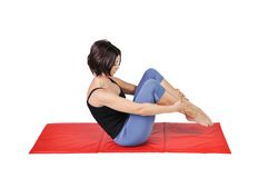 Fit young female pilates instructor Royalty Free Stock Photos