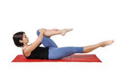Fit young female pilates instructor Royalty Free Stock Photography