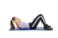 Fit young female pilates instructor Stock Image