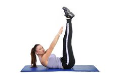 Fit young female pilates instructor Royalty Free Stock Image